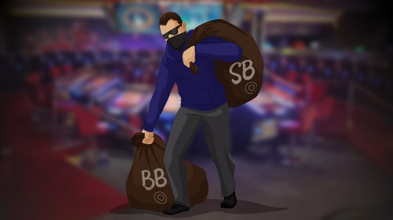 poker player dressed as a robber holding a sack full of BB and SB buttons